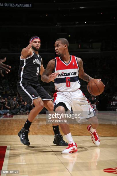 Eric Maynor of the Washington Wizards handles the ball against Deron Williams of the Brooklyn Nets at the Verizon Center on November 8 2013 in...