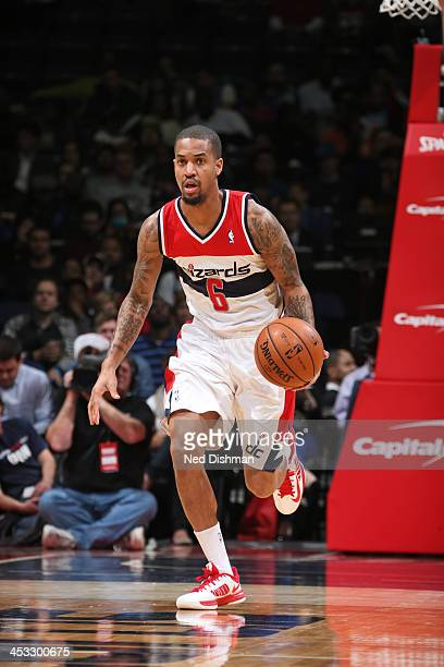 Eric Maynor of the Washington Wizards handles the ball against the Orlando Magic on December 2 2013 in Washington DC at the Verizon Center NOTE TO...