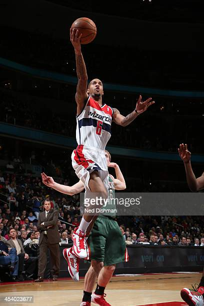 Eric Maynor of the Washington Wizards shoots against the Milwaukee Bucks during the game at the Verizon Center on December 6 2013 in Washington DC...