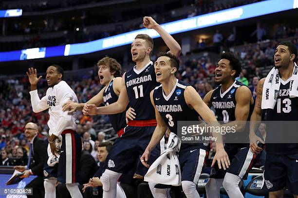 Eric McClellan Kyle Wiltjer Domantas Sabonis Kyle Dranginis Silas Melson and Josh Perkins of the Gonzaga Bulldogs celebrate from the bench late in...