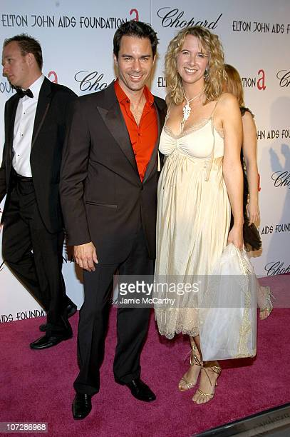Eric McCormack and Janet Holden during 13th Annual Elton John AIDS Foundation Oscar Party Cohosted by Chopard Red Carpet at Pacific Design Center in...