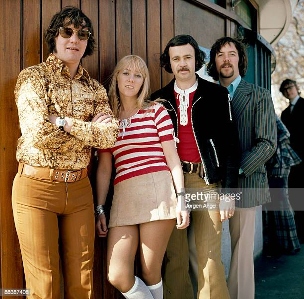 Eric McCredie Sally Carr Ken Andrew and Ian McCredie of the pop group Middle of The Road pose for a group shot in Hyde Park in 1972 in London