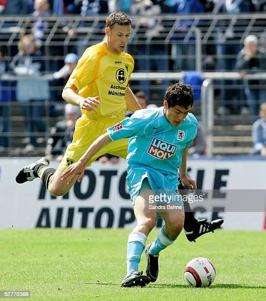 Eric Meijer of Aachen challenges Marcel Schaefer of Munich during the Second Bundesliga match between TSV 1860 Munich and Alemannia Aachen at the...