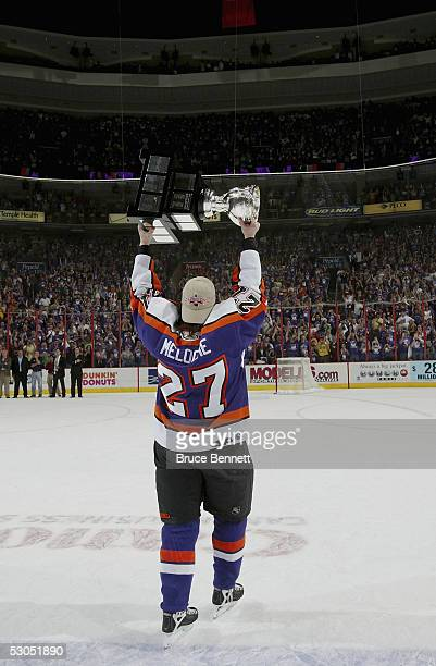 Eric Meloche of the Philadelphia Phantoms celebrates the Phantoms 52 Calder Cup win over the Chicago Wolves at the Wachovia Center on June 10 2005 in...
