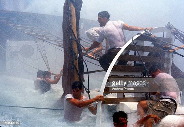 Eric Michael Cole Jeff Bridges and Scott Wolf brave a storm in a scene from the film 'White Squall' 1996