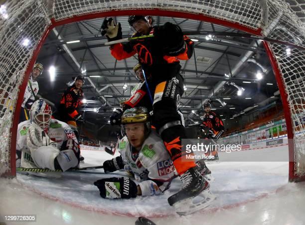 Eric Mik of Eisbären Berlin slides into the net during the Deutsche Eishockey Liga DEL match between Grizzlys Wolfsburg and Eisbären Berlin at...