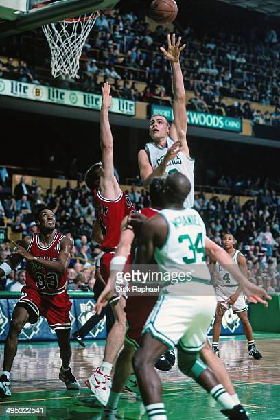 Eric Montross of the Boston Celtics shoots against the Bill Wennington of the Chicago Bulls during a game played in 1995 at the Boston Garden in...