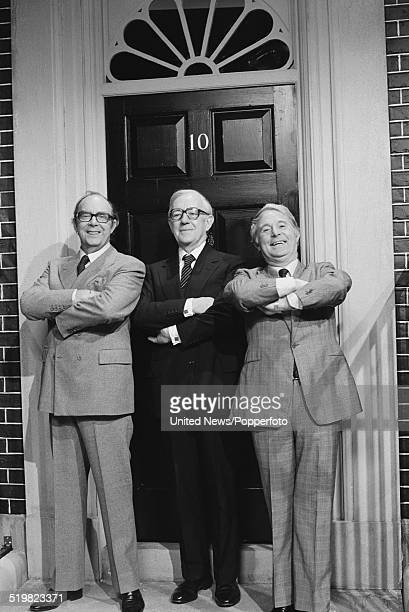 Eric Morecambe and Ernie Wise of English comedy duo Morecambe and Wise pictured together with actor Alec Guinness in centre standing outside a mock...