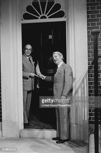 Eric Morecambe and Ernie Wise of English comedy duo Morecambe and Wise pictured together standing in a mock up set of the entrance door of 10 Downing...