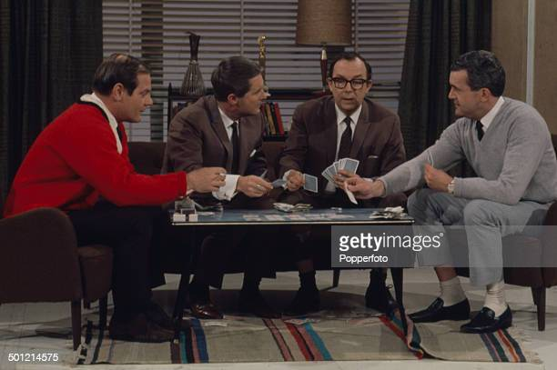 Eric Morecambe and Ernie Wise of Morecambe Wise pictured with the writers Dick Hills and Sid Green in a card game sketch from the television series...