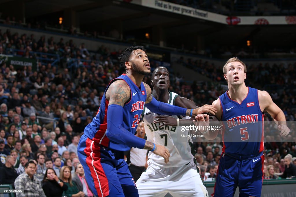 Eric Moreland #24 and Luke Kennard #5 of the Detroit Pistons box out Thon Maker #7 of the Milwaukee Bucks on December 6, 2017 at the BMO Harris Bradley Center in Milwaukee, Wisconsin.