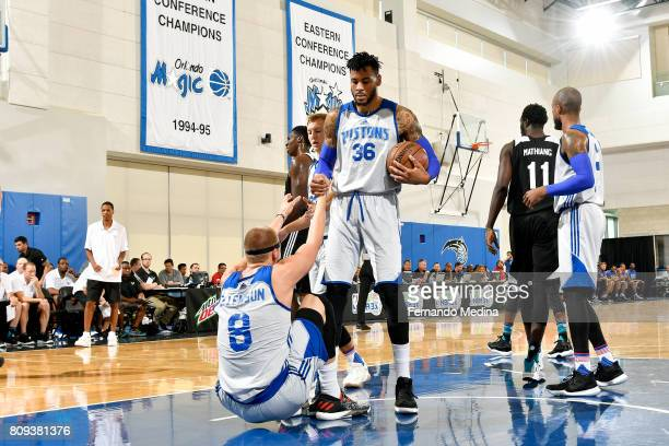 Eric Moreland helps up Henry Ellenson of the Detroit Pistons during the game against the Charlotte Hornets during the 2017 Orlando Summer League on...