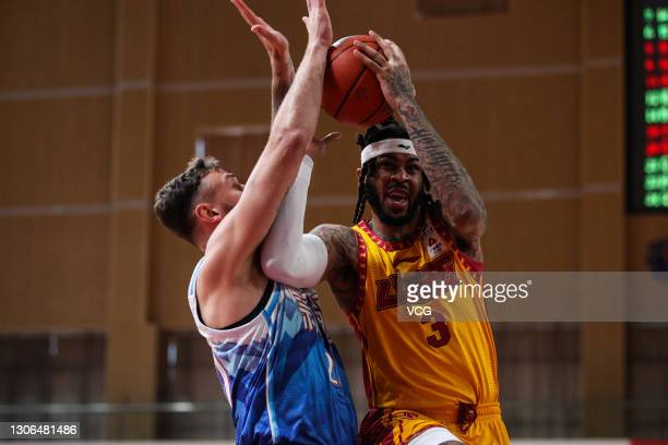 Eric Moreland of Shanxi Loongs goes to the basket against Donatas Motiejunas of Xinjiang Flying Tigers during 2020/2021 Chinese Basketball...