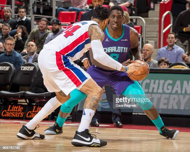 Eric Moreland of the Detroit Pistons defends against Johnny O'Bryant III of the Charlotte Hornets during the an NBA game at Little Caesars Arena on...