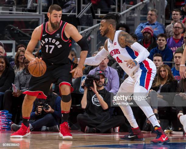 Eric Moreland of the Detroit Pistons defends against Jonas Valanciunas of the Toronto Raptors during an NBA game at Little Caesars Arena on March 7...