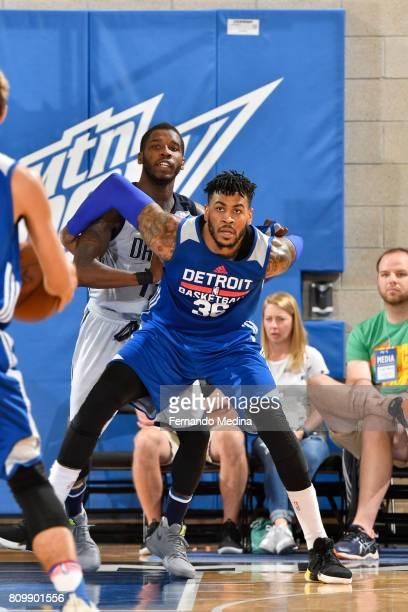 Eric Moreland of the Detroit Pistons gets position against the Dallas Mavericks of the Detroit Pistons against the Dallas Mavericks during the...