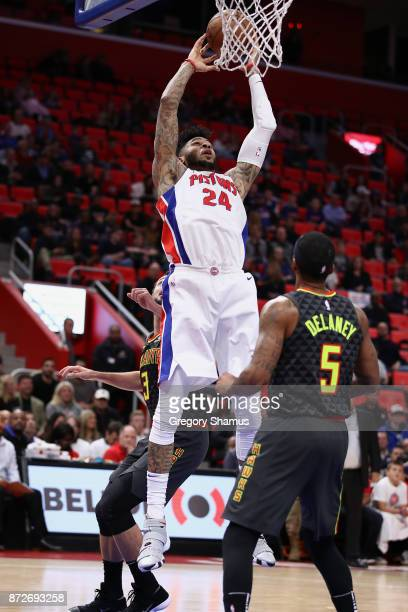 Eric Moreland of the Detroit Pistons gets to the basket behind Malcolm Delaney of the Atlanta Hawks during the second half at Little Caesars Arena on...