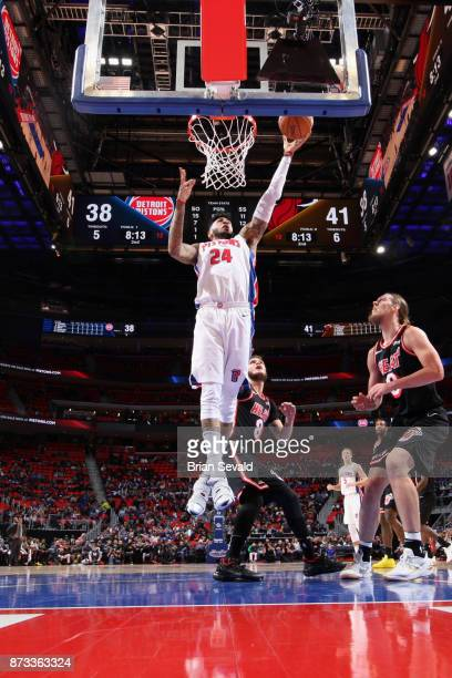 Eric Moreland of the Detroit Pistons goes to the basket against the Miami Heat on November 12, 2017 at Little Caesars Arena in Detroit, Michigan....