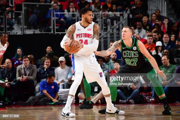 Eric Moreland of the Detroit Pistons handles the ball against Daniel Theis of the Boston Celtics on December 10 2017 at Little Caesars Arena in...