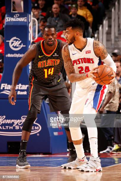 Eric Moreland of the Detroit Pistons handles the ball against Dewayne Dedmon of the Atlanta Hawks on November 10, 2017 at Little Caesars Arena in...