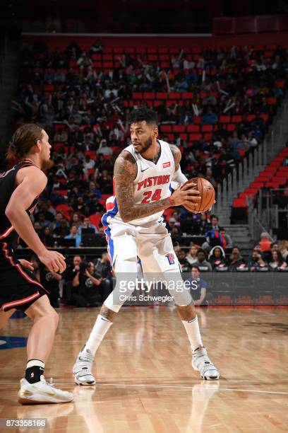 Eric Moreland of the Detroit Pistons handles the ball against the Miami Heat on November 12, 2017 at Little Caesars Arena in Auburn Hills, Michigan....