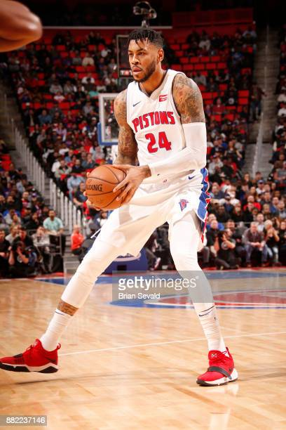 Eric Moreland of the Detroit Pistons moves to pass the ball against the Phoenix Suns on November 29 2017 at Little Caesars Arena in Detroit Michigan...