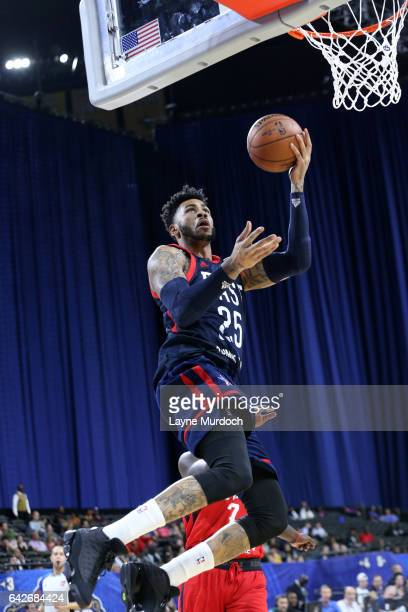 Eric Moreland of the East Team shoots against Johnny O'Braynt III of the West Team during the NBA DLeague AllStar Game presented by Kumho Tires as...