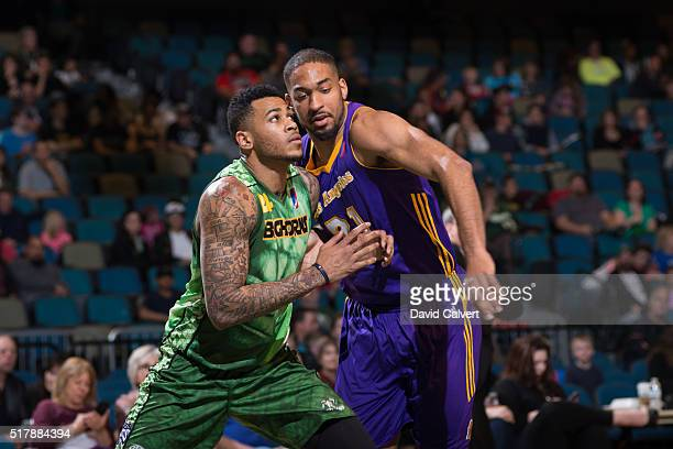 Eric Moreland of the Reno Bighorns boxes out Michael Holyfield of the Los Angeles DFenders at the Reno Events Center on March 25 2016 in Reno Nevada...