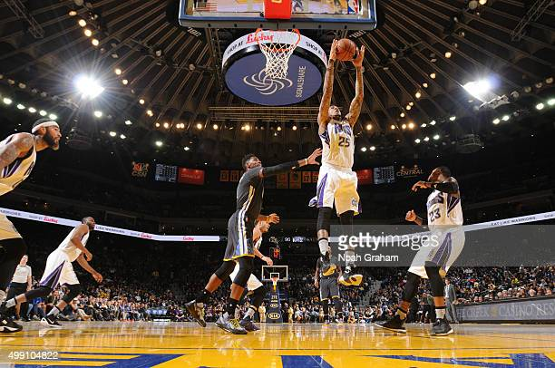 Eric Moreland of the Sacramento Kings grabs the rebound against the Golden State Warriors on November 28 2015 at ORACLE Arena in Oakland California...