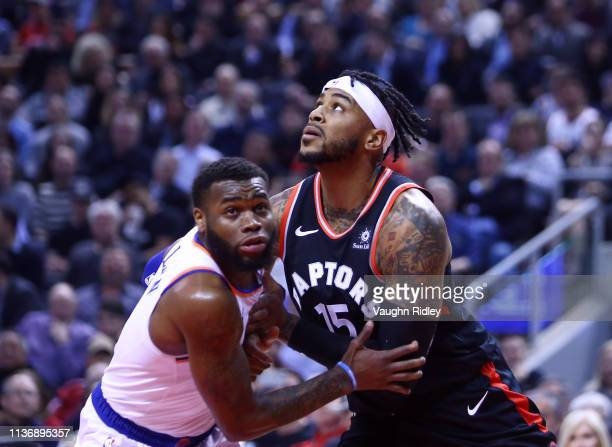Eric Moreland of the Toronto Raptors battles with Kadeem Allen of the New York Knicks during the first half of an NBA game at Scotiabank Arena on...