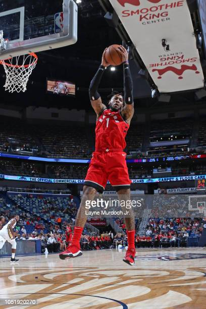 Eric Moreland of the Toronto Raptors grabs a rebound against the New Orleans Pelicans during a preseason game on October 11 2018 at Smoothie King...