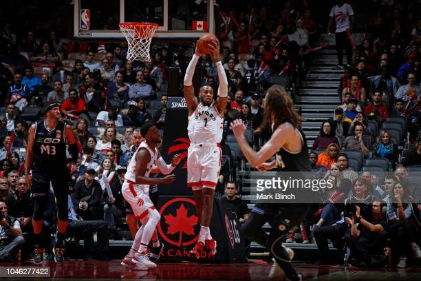 Eric Moreland of the Toronto Raptors grabs a rebound against Melbourne United during a preseason game at Soctiabank Arena in Toronto Ontario Canada...