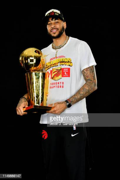 Eric Moreland of the Toronto Raptors poses for a portrait with the Larry O'Brien Trophy after winning Game Six of the 2019 NBA Finals against the...