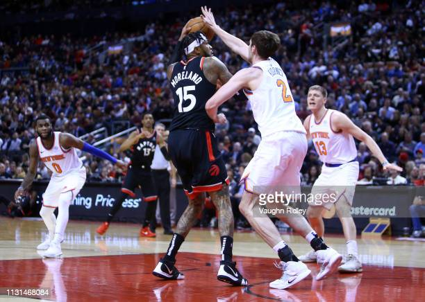 Eric Moreland of the Toronto Raptors shoots a basket as Luke Kornet of the New York Knicks defends during the second half of an NBA game at...