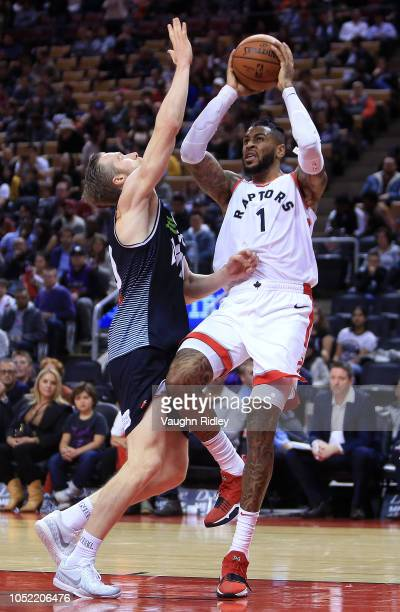 Eric Moreland of the Toronto Raptors shoots the ball as David Barlow of Melbourne United defends during the second half of an NBA preseason game at...