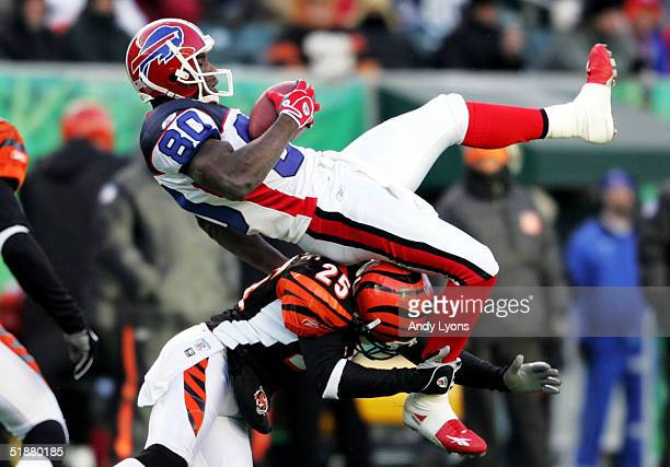 Eric Moulds of the Buffalo Bills catches a pass while defended by Keiwan Ratliff of the Cincinnati Bengals at Paul Brown Stadium on December 19 2004...