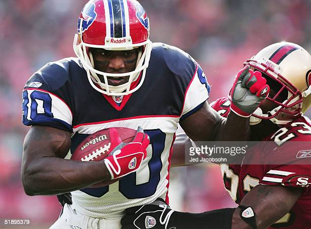 Eric Moulds of the Buffalo Bills runs with the ball against Jimmy Williams of the San Francisco 49ers at Monster Park on December 26 2004 in San...