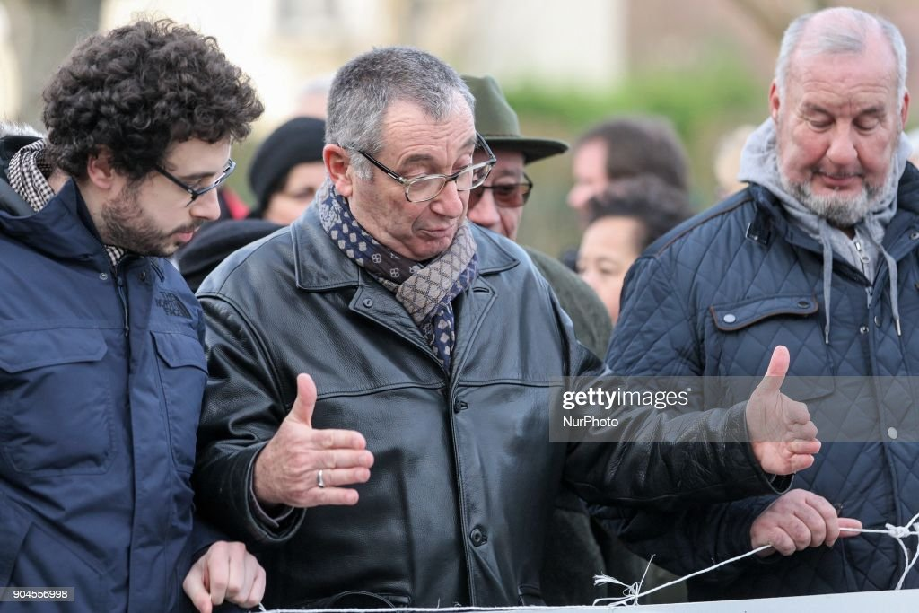 Eric Mouzin (C), the father of Estelle Mouzin, takeS part in a silent march in memory of his daughter, on January 13, 2018 in Guermantes, near Paris, fifteen years after the disappearance of the nine-year old girl. Estelle Mouzin disappeared on January 9, 2003 in Guermantes village some 25 kilometers from Brie-Comte-Robert.