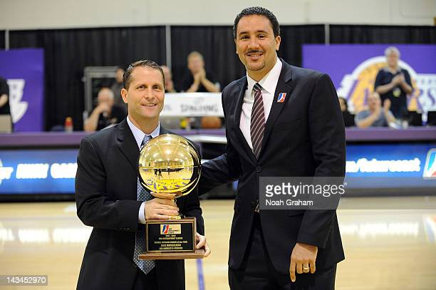 Eric Musselman head coach of the Los Angeles DFenders left is presented with the Developmental League Coach of the Year Award by DLeague President...