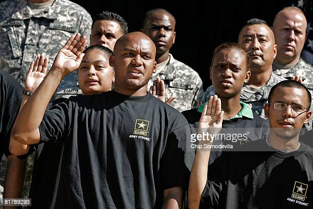 Eric Myers of Woodbridge Virginia joins 15 other new recruits or future soldiers in taking the oath to join the US Army at the Pentagon July 1 2008...