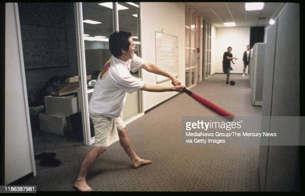 Eric Ng hits as Joonsuk Bae pitches to him during a break from writing code at around midnight at Yahoo in Sunnyvale Calif on May 24 1996