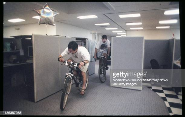 Eric Ng leads the parade through the cubicles at Yahoo in Sunnyvale Calif on May 24 1996 Coworkers follow on bikes and roller blades The parade was a...