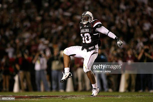 Eric Norwood of the South Carolina Gamecocks celebrates after making a defensive stop against the Tennessee Volunteers during their game at...