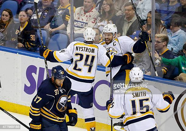 Eric Nystrom and Shea Weber of the Nashville Predators celebrate Weber's goal in the second period against the Buffalo Sabres at First Niagara Center...