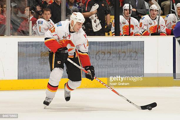 Eric Nystrom of the Calgary Flames handles the puck against the Los Angeles Kings at Staples Center on November 21, 2009 in Los Angeles, California.