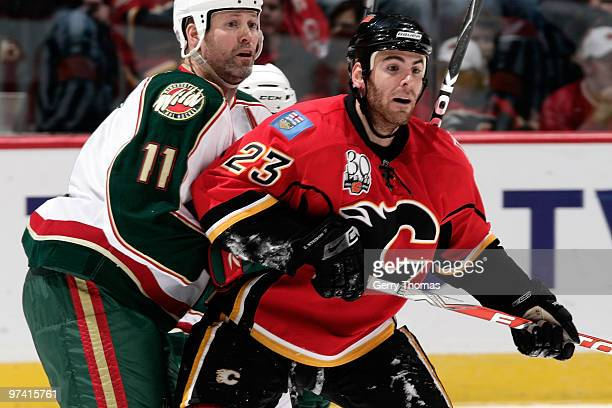 Eric Nystrom of the Calgary Flames skates against Owen Nolan of the Minnesota Wild on March 3 2010 at Pengrowth Saddledome in Calgary Alberta Canada