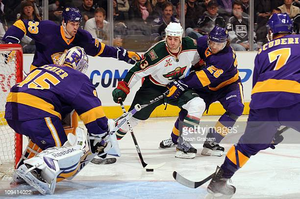 Eric Nystrom of the Minnesota Wild skates with the puck against Michal Handzus of the Los Angeles Kings at Staples Center on February 24 2011 in Los...