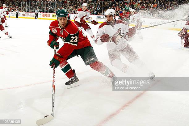 Eric Nystrom of the Minnesota Wild skates with the puck while David Schlemko of the Phoenix Coyotes defends during the game at the Xcel Energy Center...