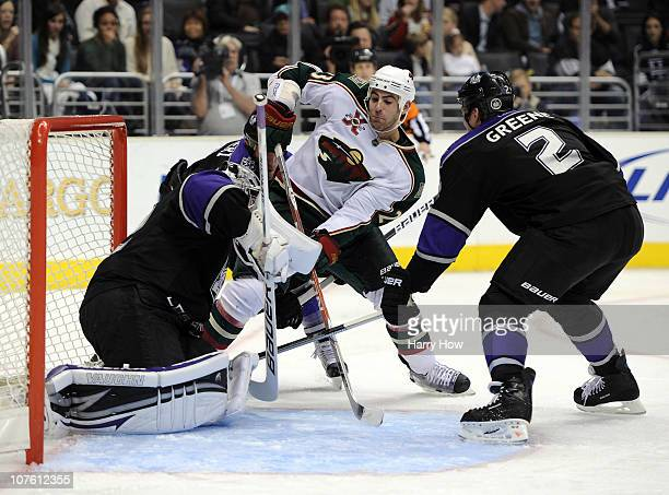 Eric Nystrom of the Minnesota Wild takes a shot on Jonathan Quick of the Los Angeles Kings as Matt Greene looks for a rebound at the Staples Center...