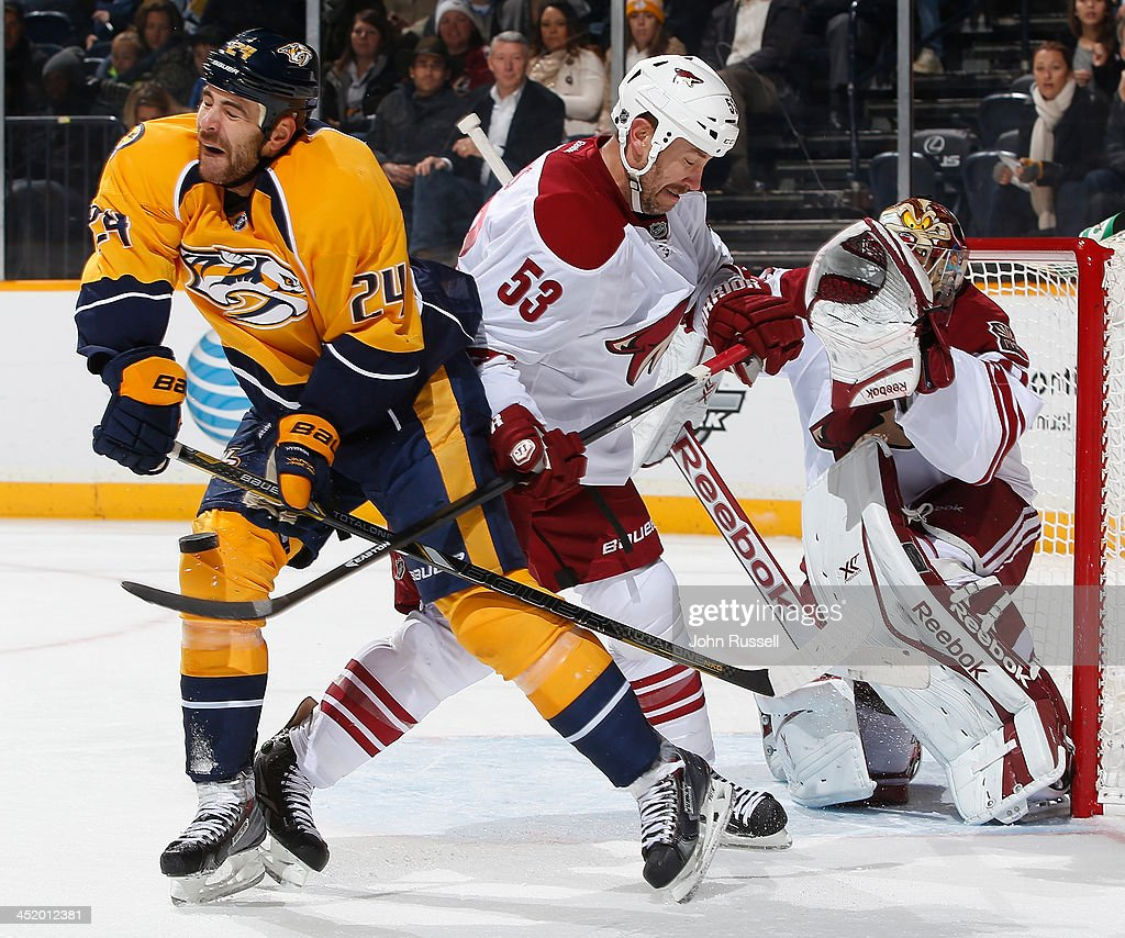 Eric Nystrom #24 of the Nashville Predators battles in front of the net against Derek Morris #53 of the Phoenix Coyotes at Bridgestone Arena on November 25, 2013 in Nashville, Tennessee.